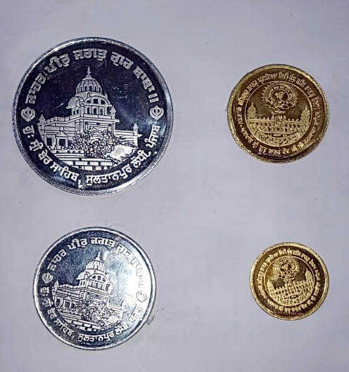 coins in the memory of Guru Nanak Dev by SGPC