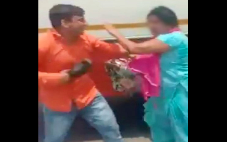 Bus conductor beats woman